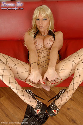 t british tgirls joanna jet fishnets 04 British Tgirl Joanna Jet Stroking Her Shemale Cock In Fishnets!