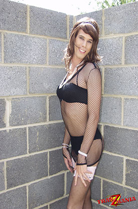t british tgirl concrete 01 Leggy British Tgirl Poses In Fishnets On TranZMania!
