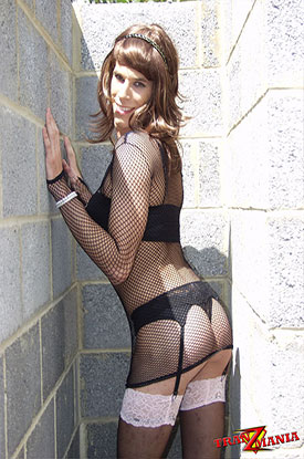 t british tgirl concrete 03 Leggy British Tgirl Poses In Fishnets On TranZMania!